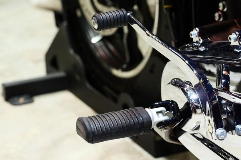 A close up of a motorcycle gear shifter pegs.