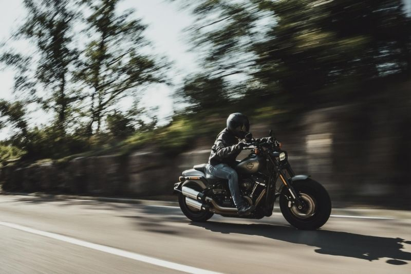 A person riding a fast motorcycle.