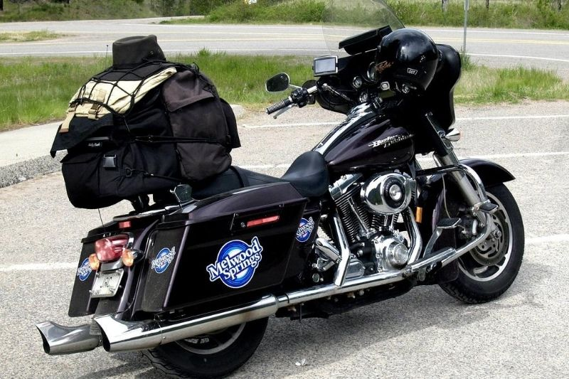 A heavy motorcycle parked on its kickstand.