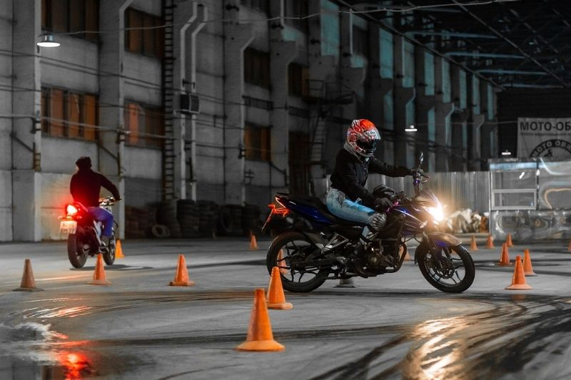 A motorcycle rider taking a training course