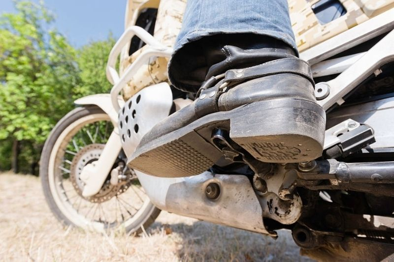 A motorcyclist with cowboy boots