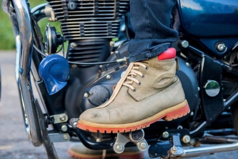A motorcyclist with hiking boots