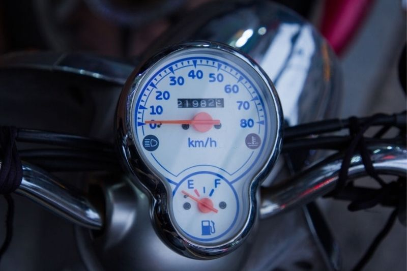 A close up of a motorcycle's dashboard.